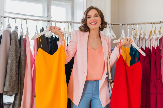 attractive-stylish-smiling-woman-choosing-apparel-clothing-store_285396-4642