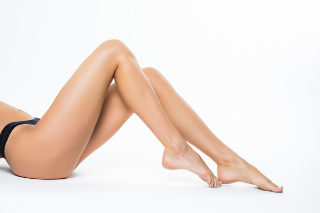 beautiful-female-legs-ass-back-body-isolated-white-wall-lying-floor-with-long-leg-beauty-spa-skin-care-concept_231208-3829