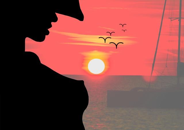 Západ slnka, silueta ženy v klobúku.jpg