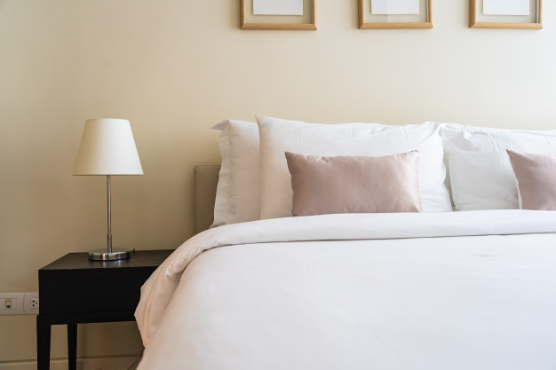 white-comfortable-pillow-bed-decoration-interior_74190-9524
